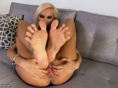 Blonde Sandy does her best to give herself as much pleasure as she can