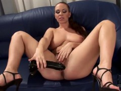 Dark haired Luscious Eden plays with her black dildo
